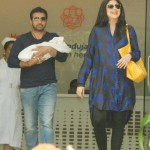 Shetty leaving Lilavati Hospital with husband Raj and son Viaan