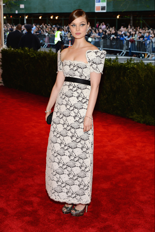 Bella Heathcote in Chanel Haute Couture, with a Chanel bag and jewels and Jimmy Choo shoes