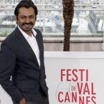 Nawazuddin Siddiqui poses during a photocall for the film 'Monsoon Shootout' at the 66th Cannes Film Festival in Cannes