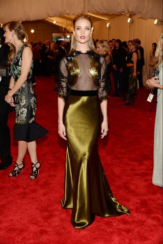 Rosie Huntington-Whiteley, in Gucci, with Lorraine Schwartz jewels